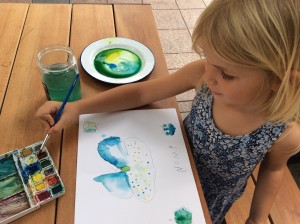 Nomi making colours float on her butterflies