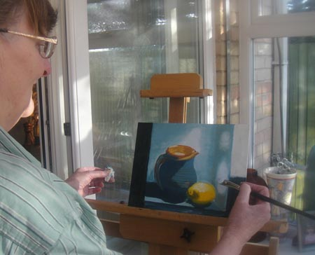 Sue with her second ever oil painting.
